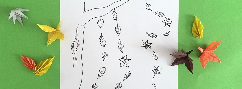Eine Strichzeichnung mit verschiedenen fallenden Blättern liegt auf einer grünen Pappe, um rahmt von Blätter-Origamis.