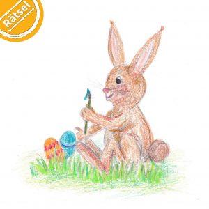 """Buntstift-Zeichnung: Osterhase sitzt im Gras und bemalt Eier. Symbol oben links: Halber Kreis mit Text """"Rätsel"""".."""